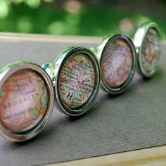 custom vintage map drawer pull cabinet knobs BUT i was thinking how cool would it be to find 3 or 5 round frames and put old maps in them for wall art?  pretty cool, right?!