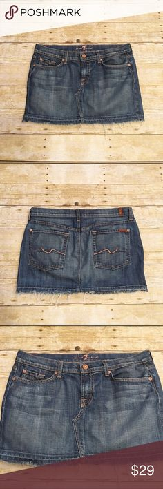 7 For All Mankind denim Roxy skirt, size 31 Beautiful 7 For All Mankind denim skirt in a size 31. Style name is Roxy. No flaws at all, great condition. Waist- approximately 17 inches, total length- approximately 12.5 inches. 7 For All Mankind Skirts Mini