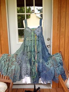 Custom crochet dress done in peacock blues and greens ..lots of ruffles and a silk accent ribbon ... fits small -xl