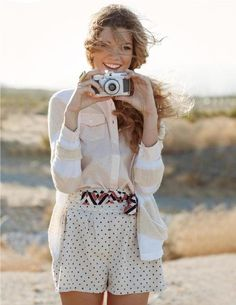 Subtle print mixing; striped cardigan, polka dot shorts and geo print belt