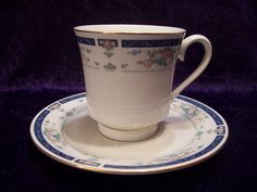 Lynns Fine China With Pink and Blue Roses With A Nice Blue Trim. Made in China