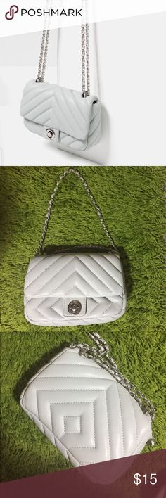 Zara quilted small cross body bag Zara quilted small bag. Can be either cross body or shoulder bag by adjusting the chain. Only used several times. Not very big, but enough for iPhone 6 and a key chain or lipsticks. Color is light blue. Zara Bags Crossbody Bags