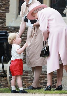 Prince George chatting with Great Grandma, Queen Elizabeth II after the christening of his little sister, Princess Charlotte.