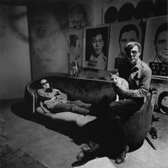 Andy Warhol in his studio with Robert Indiana and cats, 1964. Andy loved animals, and we're not sure if these are his studio cats, but it's worth noting that the artist once owned 25 cats — all named Sam. His series of 25 cat prints were not based on his own cats, but that of New York photographer Walter Chandoha.
