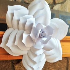 Now offering the template to this popular paper flower! Recreate as many flowers as you would like with this easy, step-by-step, full photograph tutorial.