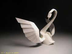 Origami Swam By Hoàng Tiến Quyết.  Yes there is a tutorial for this amazing piece!!