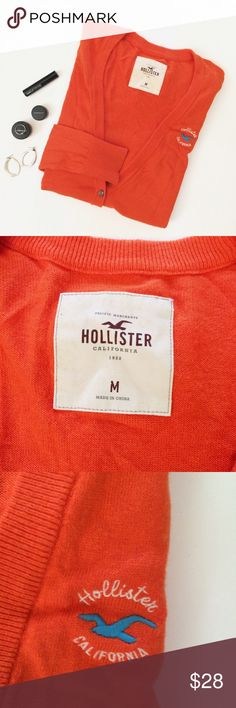 Orange Long Sleeved Hollister V-Neck Cardigan This fun and trendy, Orange Hollister v-neck cardigan is perfect for any season! The bright orange is sure to make any outfit pop! It is in great condition and has a blue seagull on the top side! Size medium, check it out! Hollister Sweaters Cardigans