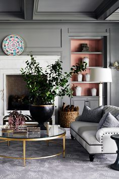 Accessorize to draw out your gray. Choosing paint is scary.  Love the bookshelves with that alternative color.