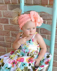 Listing is for one tropical orange lace bow headband.    We love everything girly, so these adorable lace bows are the best. We love big bows and are