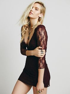 When In Rome Slip   Floral lace V-neck slip with sheer sleeves and raw trim detailing.