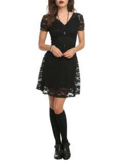 Black+floral+lace+dress+with+a+solid+black+underlay+and+back+zipper+closure.
