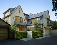 flared eaves, cream stucco, taupe trim. toth construction.