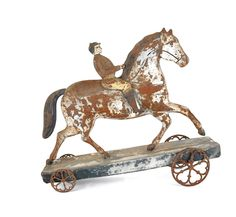 "Large painted tin horse and rider pull toy, 19th c., 11 1/2"" h., 14"" l."