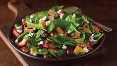 Baby spinach tossed with freshly sliced strawberries, oranges, red grapes, dried cranberries, green onions, creamy goat cheese and raisin pecan sweet crisps, drizzled with pomegranate vinaigrette.