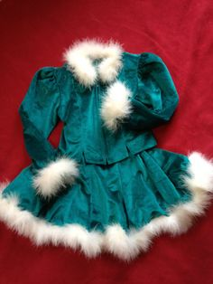 Girls' skating costume in emerald green velour with white feather boa trim