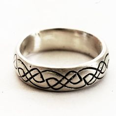 Celtic Wedding Ring With Engraved Woven Knotwork by Spoonier, $60.00