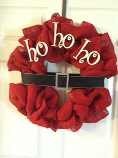 Beautiful Handmade Christmas burlap wreath with ho, ho, ho on it. Red burlap, with wood letters and black ribbon.