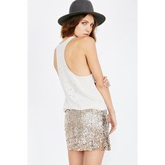 Super fun sequin mini skirt from free-spirited label Love Sadie. Fitted skirt with allover sequin detailing cut above-the-knee.