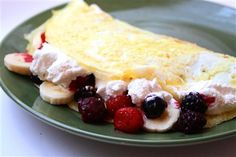 A fluffy omelet with mixed berries, bananas, pineapple and a creamy filling - inspired by the Humpty's Temptation Omelet! (healthy version!)