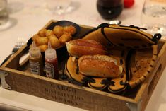"""Snacks in Baseball Mitts: In New York, Scoozi Events hosted a dinner with a """"childhood memory"""" theme in Nostalgic dishes included miniature Kobe hot dogs served in a baseball mitt with a side of tater tots in a batting helmet. Wedding Reception Appetizers, Hot Dog Toppings, Cooking Competition, Dinner Club, Popcorn Bar, Midnight Snacks, Dinner Themes, Food Stations, Themed Cupcakes"""