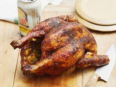 Beer Can Chicken : Preparing juicy beer-can chicken is easier than it looks. Just make sure before you get started that the beer can fits inside the chicken and that your grill can accommodate the height of an upright bird. You don't want to lower the lid of your grill only to find that the chicken doesn't fit.