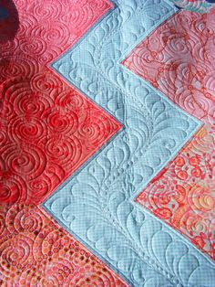 close up of quilting by Tia Curtis Quilts: A Quilt for Joy: echo swirls and fancy feathers
