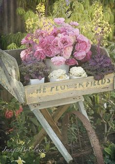 pink roses and cabbage roses on a vintage flower stand