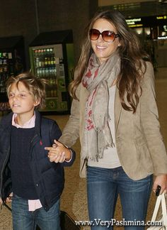 #LizHurley Wears A Dusty Rose And #BeigeScarf In Melbourne