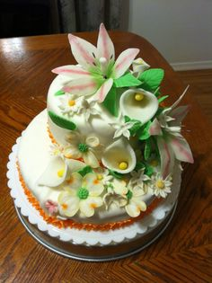 Love flower - I made this cake for my mother, I Made every flower of fondant and gumpaste.Vanilla cake with almond flavor buttercreme icing.