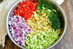 ingredients in a metal mixing bowl laid in side by side: macaroni, chopped pepper, chopped onions, chopped celery, green onions and herbs Homemade Macaroni Salad, Macaroni Salad Ingredients, Macaroni Cheese Recipes, Tortellini Recipes, Pasta Salad Recipes, Avocado Recipes, Side Recipes, Beef Recipes, Snacks Recipes