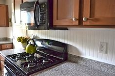 BEADBOARD BACKSPLASH 5 Things to Do... With Beadboard - Bob's Blogs Whitewashed beadboard can do wonders to brighten up a drab kitchen.