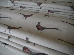 Two interlined roman blinds in Flohr & Co Pheasants fabric, handmade by Victoria Clark Interiors.