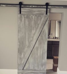 Made this barn door with grey base and white washed and dry brushed finish. Black hardware.