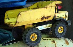 In the late the Mound Metalcraft Co., a small garden-implement business operating out of a Minnesota school basement, began making toy trucks. It started with steam shovels and cranes, and in. Best Memories, Childhood Memories, School Memories, School Days, High School, New Trucks, Tonka Trucks, Tonka Toys, Old School Toys