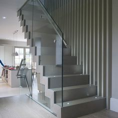 floating zig zag staircases, glass works well for the banisters which the house needs for health and safety with the grandparents and children living here, but the glass gives the illusion of no banisters