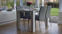 White Gloss Dining Table with Grey Leather Dining Chairs