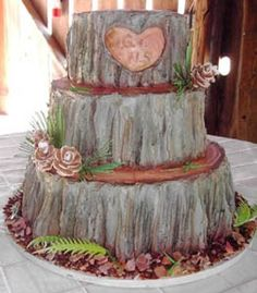 The couple were foresters and had requested a butter cream iced cake, stacked, but the outside to resemble the bark of the trees in which they work and love.    *Cake 40