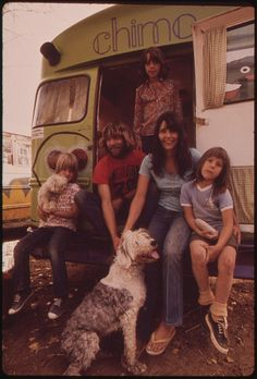 Hippies living in a converted school bus. Photo by David Hiser, Oct. 1972  What says hippie more than living in an old bus with your family and dogs? These folks, at least in October 1972, were calling Rifle, Colorado, home.