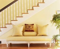 Cheery and welcoming entryway: subtle yellow wall color; pretty yellow fabric on the bench; and warm tones of the hard wood floor. Yellow Hallway, Yellow Walls, Traditional Benches, Yellow Cottage, Color Pick, Outdoor Sofa, Outdoor Decor, Atlanta Homes, Yellow Fabric