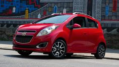 The 2013 Honda Fit Sport and the 2013 Chevrolet Spark are good small compact car models if you are looking for economy too. 2013 Chevy Spark, Chevrolet Spark, Spark 2013, 2013 Honda Fit, New Chevy, Hatchback Cars, Automotive Group, City Car, Cars