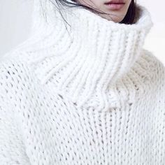 There's nothing more satisfyingthan when a soft knit sweater feels just as sumptuous and comfortingas snuggling up to your favorite blanket. This is why I'm lusting after Stéphanie Caulier's collection of oversized and ultra-soft hand knitted jumpers, cardigans and scarves. All that beautifully