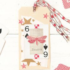 Make a project more festive by adding a playing card and tissue paper like Janice Long did on this tag. See more of Janice's work in Take Ten Summer 2014!
