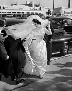 17-year-old Elizabeth Taylor wearing a beautiful Long Satin Wedding Dress for her 1950 wedding to Conrad Hilton, Jr.