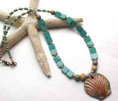Necklace by Annie C Breeze with Clayworks Stoneware Scallop Shell Pendant.