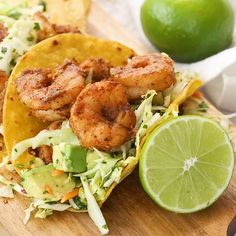 These easy shrimp tacos with cabbage slaw come together in less than 20 minutes and taste better than any restaurant. A delicious gluten free lunch or dinner, this healthy recipe from Slender Kitchen has 4 Weight Watchers Freestyle SmartPoints and is also Shrimp Taco Recipes, Fish Recipes, Mexican Food Recipes, Chicken Recipes, Shrimp Taco Seasoning, Shrimp Dinner Recipes, Shrimp Meals, Fish Taco Sauce, Tilapia Recipes