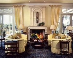 18th century antique French limestone fireplace was selected to balance the tall French doors on either side in this remodeled Montecito ranch style home. Color palate was taken from the 19th century Agra rug.