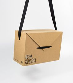 Sara Palen's Ida Hillebjork Shoe Packaging Box Doubles as a Bag #branding trendhunter.com