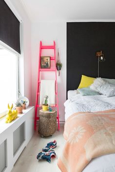Bedroom with neon pink ladder