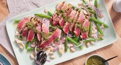 Lightly seared to perfection, these tender Barbecued Salsa Verde Tuna Steaks are incredible. Recipe by Em's Food for Friends. Seafood Dishes, Seafood Recipes, Dinner Recipes, Artichoke Salad, Lemon Green Beans, Tuna Steaks, Salsa Verde, Christmas Recipes, Barbecue