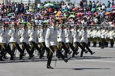 Staff officers and cadets of the Chilean police academy (Escuela de Carabineros de Chile) marching through O'Higgins Park in Santiago at the 2016 Chilean Army Day Parade.